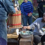 Students learn how to make apple cider