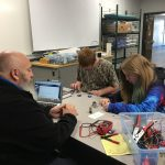 Students learning electrical circuits