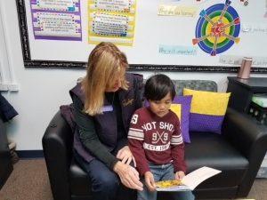 Volunteer helps a student