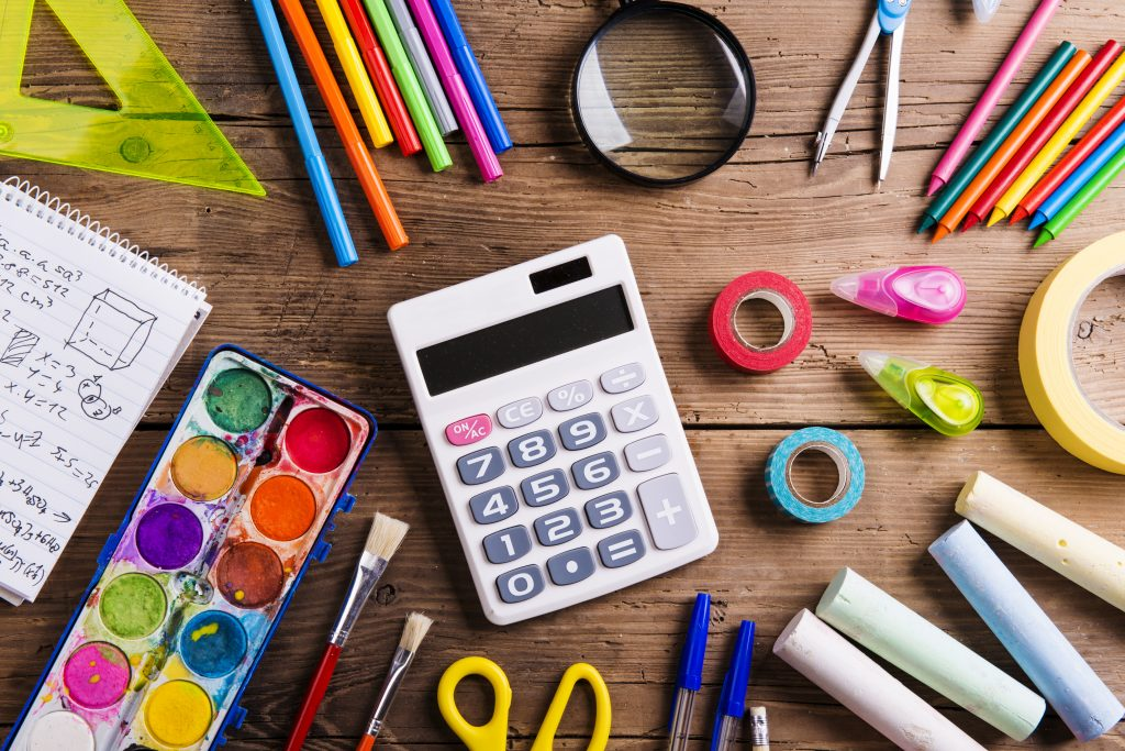 school supplies on wood background